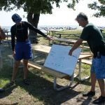 Commodore Tomaso explains the course to Clyde and Eugene.